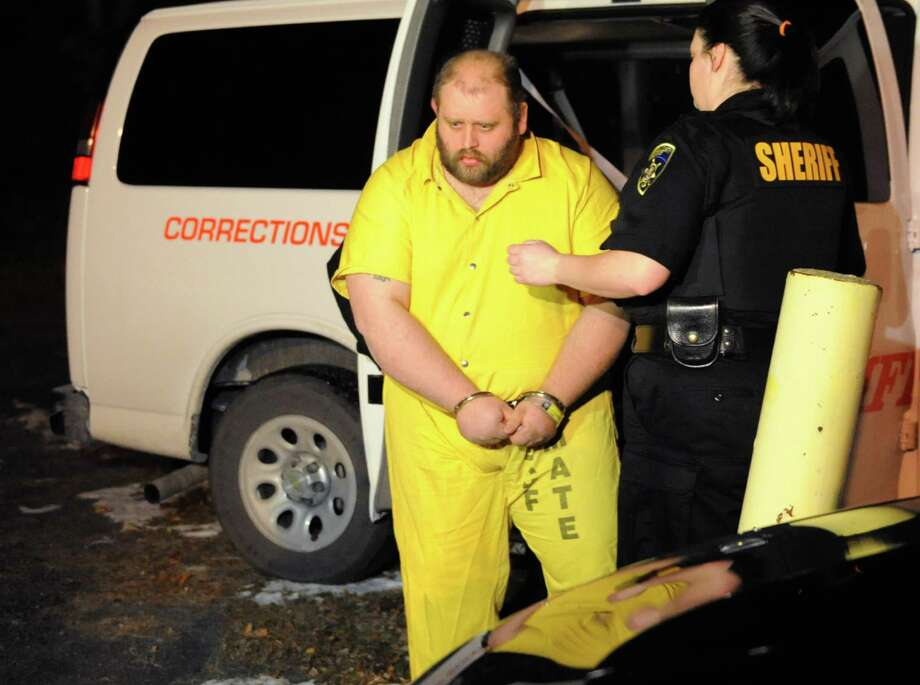 Steven Walker, accused of using pliers to pull out teeth from an 8-year-old disabled girl, arrives for his arraignment in court on Monday, Nov. 25, 2013 in Wright, N.Y.. (Lori Van Buren / Times Union) Photo: Lori Van Buren / 00024797A