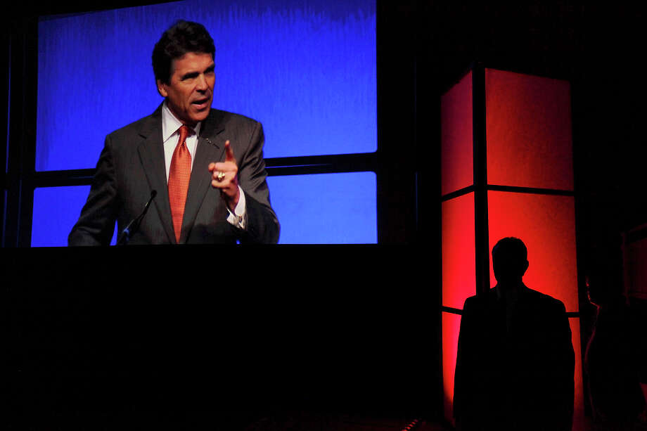 A member of Perry's security detail stands near the stage as he speaks during the 2012 Texas GOP Convention held at the Fort Worth Convention Center. Photo: Edward A. Ornelas, Staff / © 2012 San Antonio Express-News