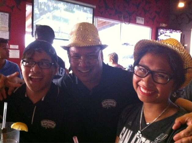 The Balakit family is all blinged-out in honor of the Spurs as they watch Game 5 at Freetail Brewing Co. on Sunday, June 15, 2014. Photo: Jennifer R. Lloyd, San Antonio Express-News