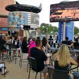 Spurs fans cheer in the start if the second quarter at the Bud Light courtyard watch party on Sunday, June 15, 2014.