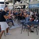 Fans jump from their seats as Manu scores in the second quarter at Bud Light Courtyard on Sunday, June 15, 2014.