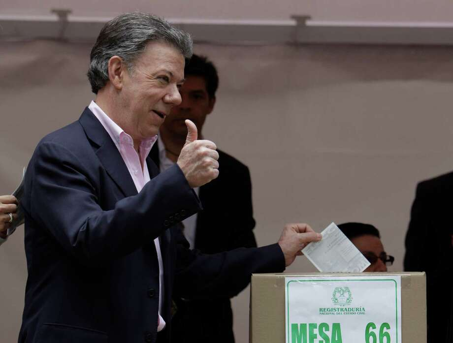 President Juan Manuel Santos casts his ballot during presidential elections in Bogota, Colombia, Sunday, June 15, 2014. Santos is seeking a second four-year term as candidate for the Social Party of National Unity. (AP Photo/Javier Galeano) Photo: Javier Galeano, STR / AP