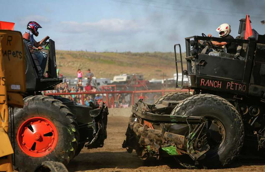 Drivers are about to collide during the 27th annual Lind Lions Club Combine Demolition Derby in Adams County. During the event drivers smash the multi-ton machines against competitors until only one machine remains.