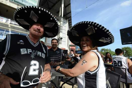 Sam and Irene Dubberly wear Spurs colors before game 5 of the NBA finals in the Alamodome on Sunday, June 15, 2014. Photo: Billy Calzada, . /  San Antonio Express-News