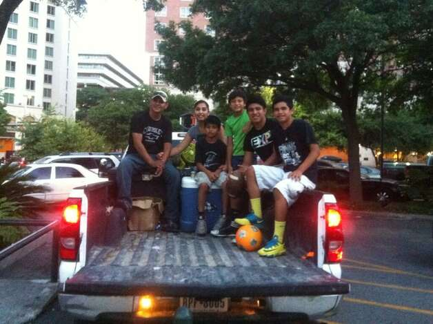 The Salame family was in place for a Spurs win on Sunday night, June 15, 2014. They have been parking their truck on Navarro and Commerce to listen to Spurs games since 2004. Photo: Breanna Kerr/San Antonio Express-News