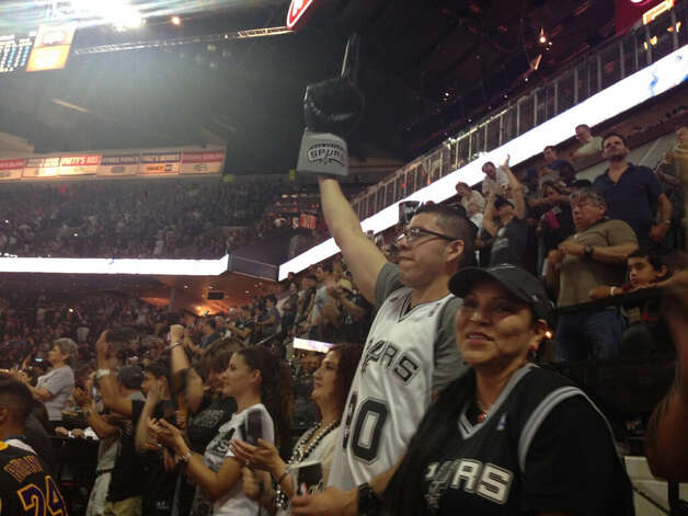 Fans cheer the Spurs at the AT&T Center during Game 5 on Sunday, June 15, 2014. Photo: Rebecca Salinas/San Antonio Express-News