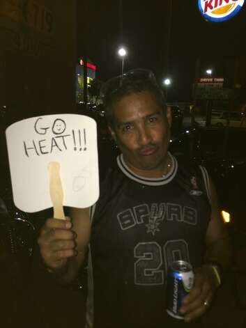 A Spurs fan gives a sad look for the Heat during Game 5 of the NBA Finals on Sunday, June 15, 2014. Photo: Rebecca Fiedler/San Antonio Express-News