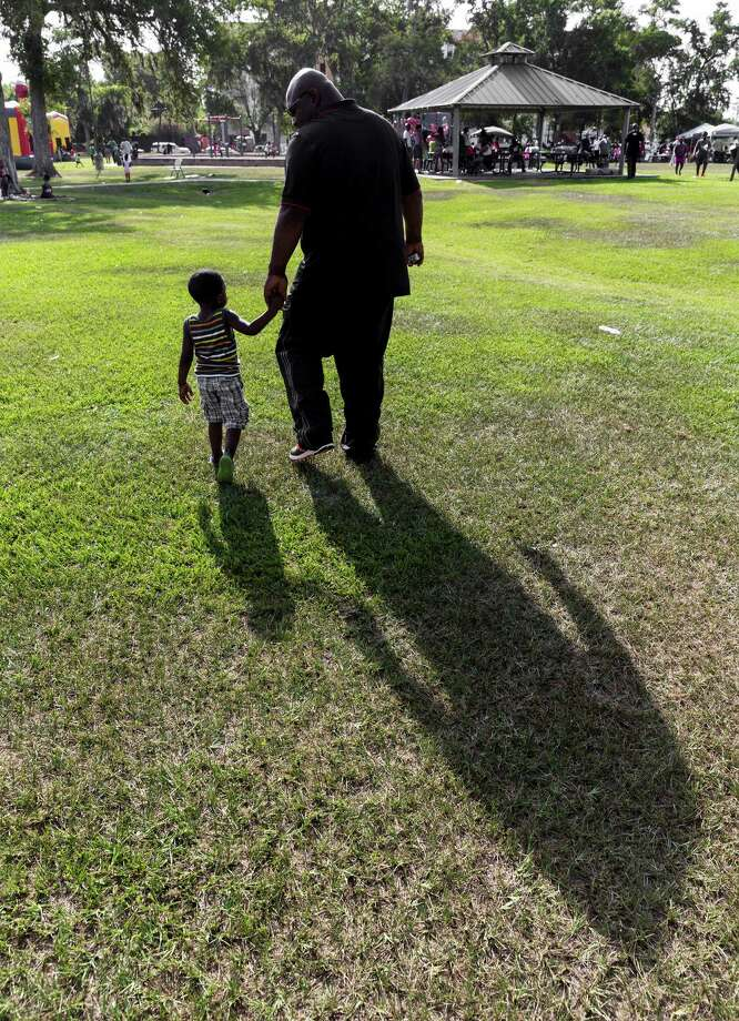 "Joseph Hutchinson, 3, and his father, Silvan Hutchinson, visited MacGregor Park on Sunday for a ""Day of Encouragement"" for black fathers. Photo: Craig Hartley, Freelance / Copyright: Craig H. Hartley"
