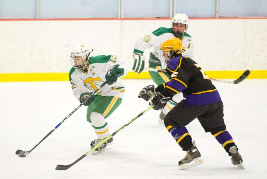 Trinity's Chris Lambrinakos, left, and Westhill's Tyler Rich, right, during an FCIAC boys hockey game at Terry Conners Rink in Stamford, Conn. on Monday, Feb. 15, 2010.