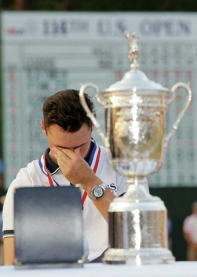 Germany's Martin Kaymer gets emotional behind the trophy after becoming only the seventh U.S. Open champion to win wire-to-wire in the tournament's 114 years. Photo: Eric Gay / Associated Press / AP