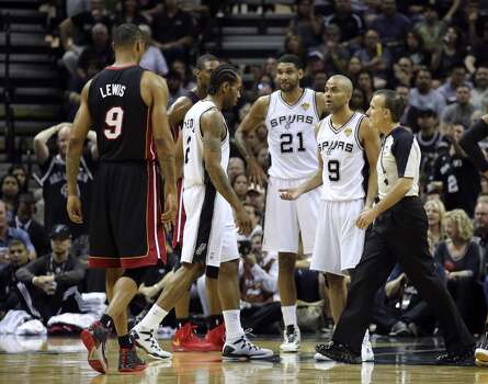 San Antonio Spurs' Tony Parker questions a foul during first half action in Game 5 of the 2014 NBA Finals Sunday June 15, 2014 at the AT&T Center. Photo: San Antonio Express-News