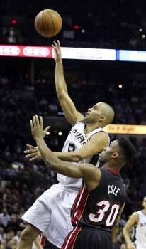 San Antonio Spurs' Tony Parker drives past Miami Heat's Norris Cole for a basket during first half action in Game 5 of the 2014 NBA Finals Sunday June 15, 2014 at the AT&T Center. Photo: San Antonio Express-News