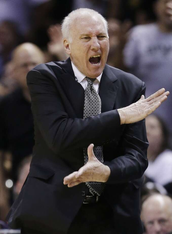 San Antonio Spurs head coach Gregg Popovich reacts against the Miami Heat during the first half in Game 5 of the NBA basketball finals on Sunday, June 15, 2014, in San Antonio. (AP Photo/David J. Phillip) Photo: Associated Press