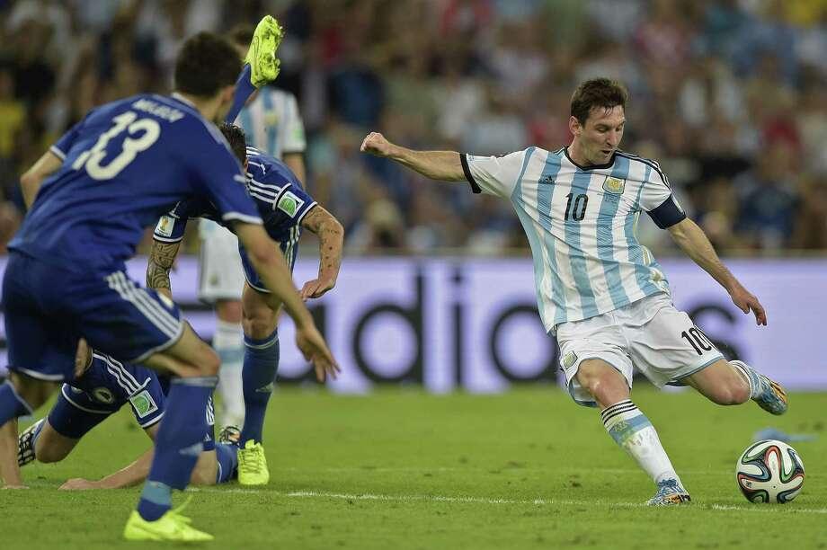 June 15  Argentina 2, Bosnia-Herzegovina 1 Photo: JUAN MABROMATA, Staff / AFP