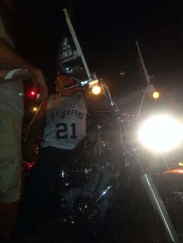 A motorcycle rider joins the Spurs celebration on West Commerce Street on Sunday, June 15, 2014. Photo: Ellery Jividen/San Antonio Express-News