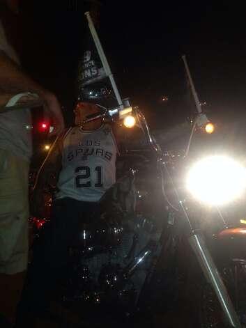 A motorcycle rider joins the Spurs celebration on West Commerce Street on Sunday, June 15, 2014. Photo: Ellery Jividen/San Antonio Express-News