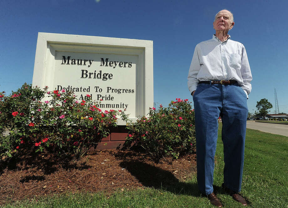 Former Mayor Maury Meyers stands next to the sign at the foot of the bridge that shares his namesake.