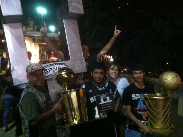 """""""Every time they win a trophy, I make a trophy"""" said Larry Villarria, who's been making them since '99. Photo: Breanna Kerr/San Antonio Express-News"""