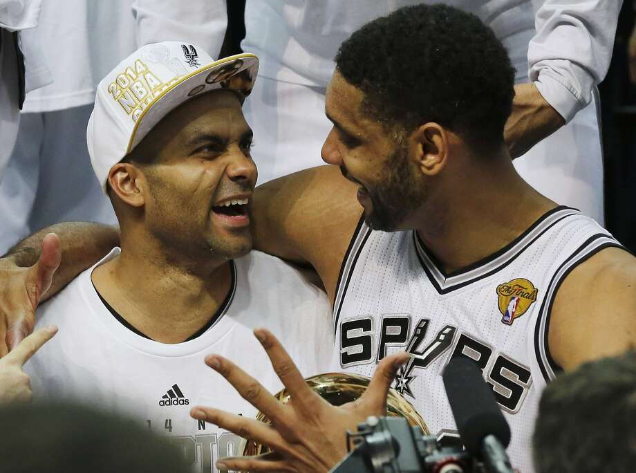 The Spurs' Tony Parker (left) and Tim Duncan celebrate after winning the NBA championship in Game 5 of the Finals. Photo: David J. Phillip, Associated Press