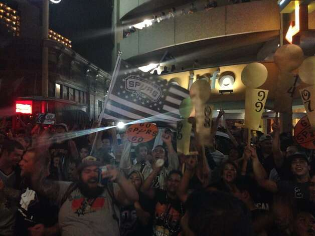 Spurs fans party downtown after the team won its fifth NBA title on Sunday, June 15, 2014. Photo: Rebecca Salinas/San Antonio Express-News