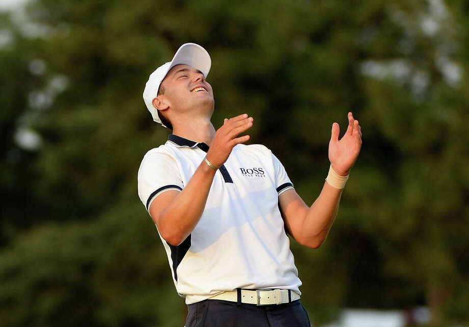 Even though he won the U.S. Open by eight strokes, Martin Kaymer couldn't relax until he sank his final putt on the 18th green. Photo: Ross Kinnaird, Staff / 2014 Getty Images