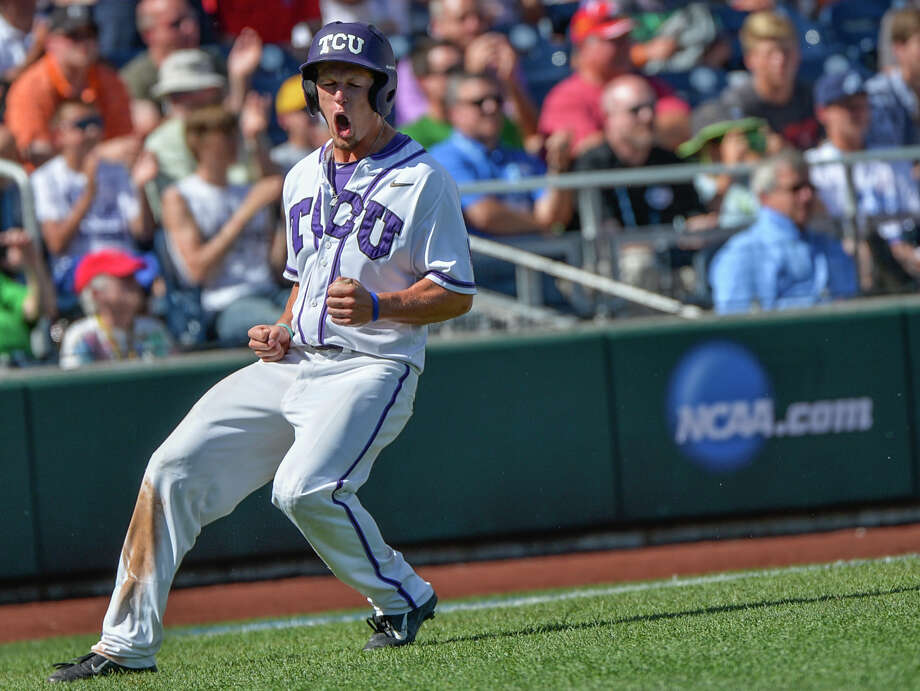 TCU's Cody Jones celebrates what turns out to be the game-winning run against Texas Tech as he scores on Boomer White's two-out single in the eighth inning. Photo: Ted Kirk, FRE / FR34398 AP