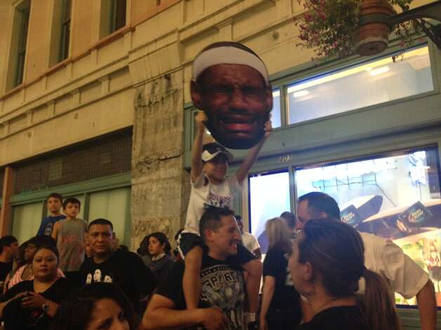A Spurs fan holds up a crying LeBron James face downtown after the Spurs won their fifth title on Sunday, June 15, 2014. Photo: Rebecca Salinas/San Antonio Express-News