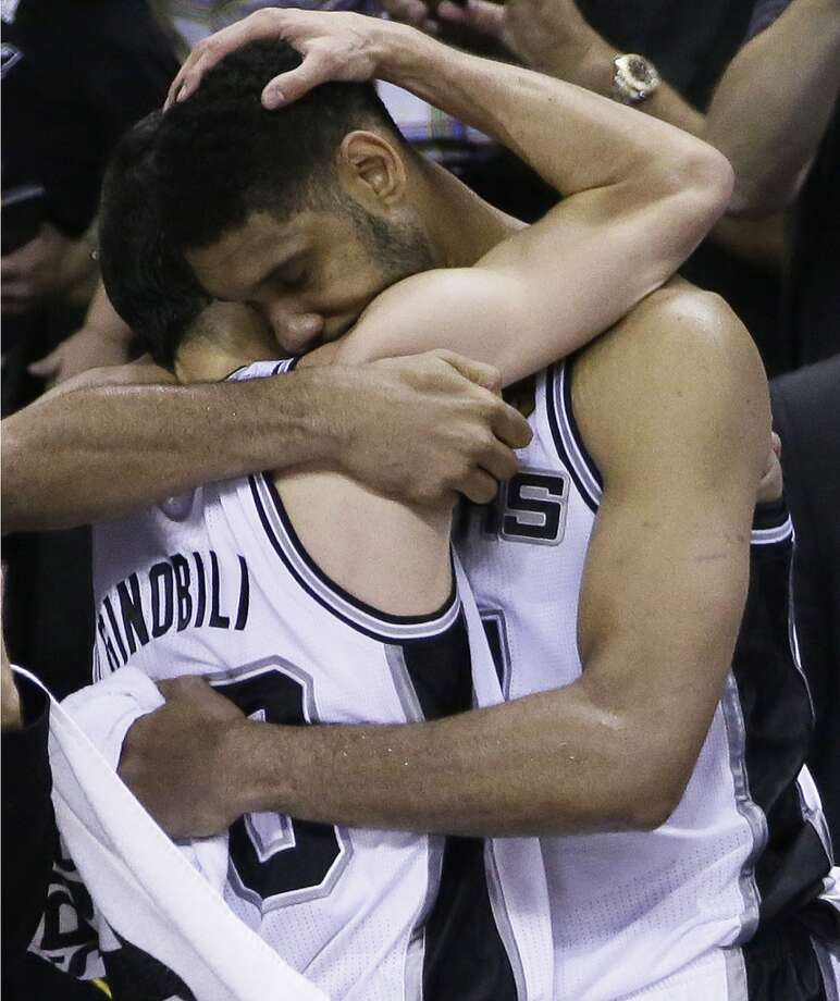 Manu Ginobili, left, and Tim Duncan embrace in the final moments of Game 5. Photo: Tony Gutierrez, Associated Press