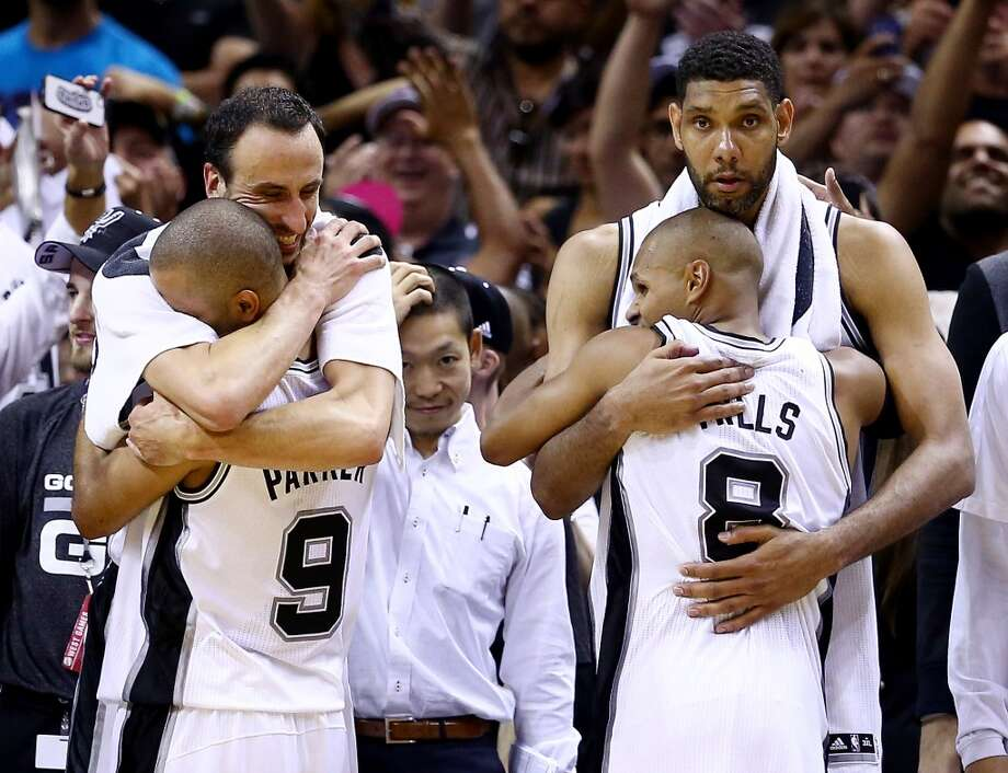 Manu Ginobili, 20, Tony Parker, 9, Patty Mills, 8 and Tim Duncan, 21 celebrate on the bench in the closing minutes of Game 5. Photo: Andy Lyons, Getty Images