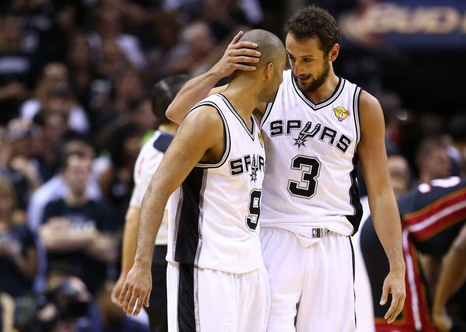 Tony Parker, left, celebrates with Marco Belinelli during Game 5. Photo: Andy Lyons, Getty Images