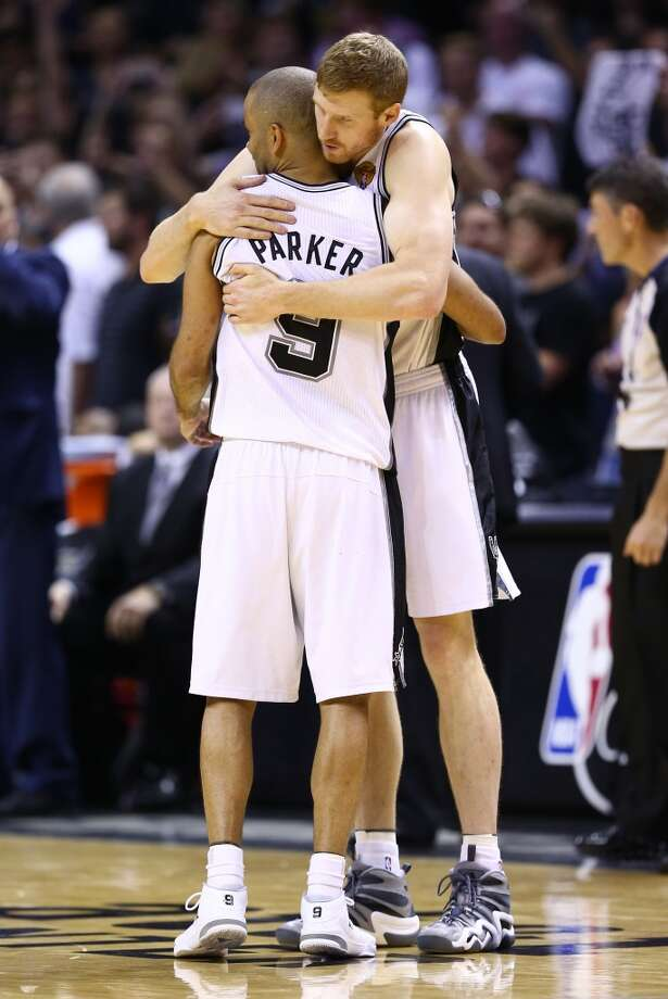 Matt Bonner and Tony Parker celebrate during Game 5. Photo: Andy Lyons, Getty Images