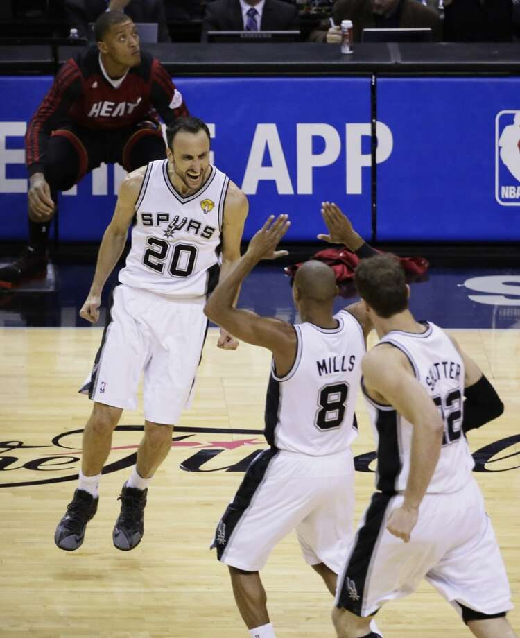 Manu Ginobili (20), Patty Mills (8) and Tiago Splitter (22) celebrate during the second half in Game 5. Photo: Tony Gutierrez, Associated Press