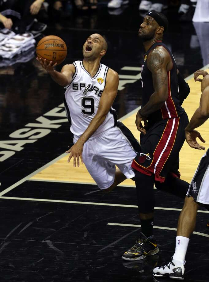 Tony Parker drives to the basket against LeBron James during Game 5. Photo: Chris Covatta, Getty Images