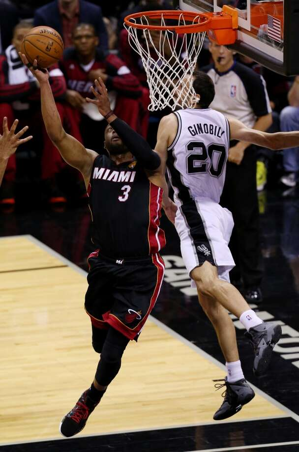 Dwyane Wade goes to the basket against Manu Ginobili during Game 5. Photo: Chris Covatta, Getty Images
