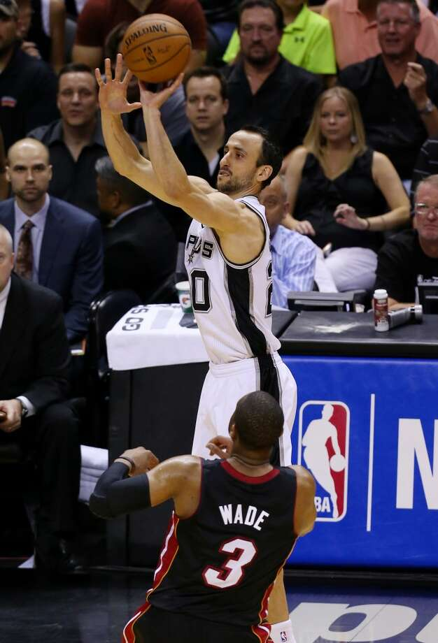Manu Ginobili takes a shot over Dwyane Wade during Game 5. Photo: Chris Covatta, Getty Images