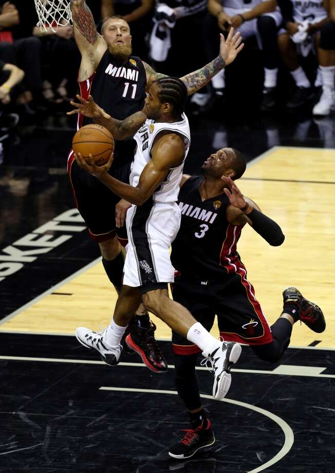 Kawhi Leonard goes to the basket against Chris Andersen during Game 5. Photo: Chris Covatta, Getty Images