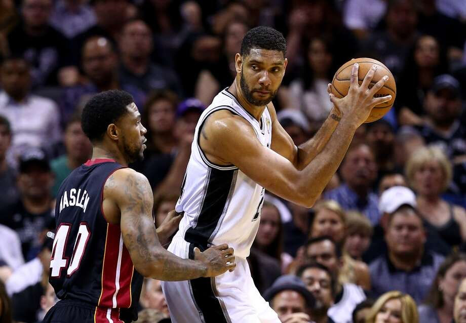 Udonis Haslem defends against Tim Duncan during Game 5. Photo: Andy Lyons, Getty Images