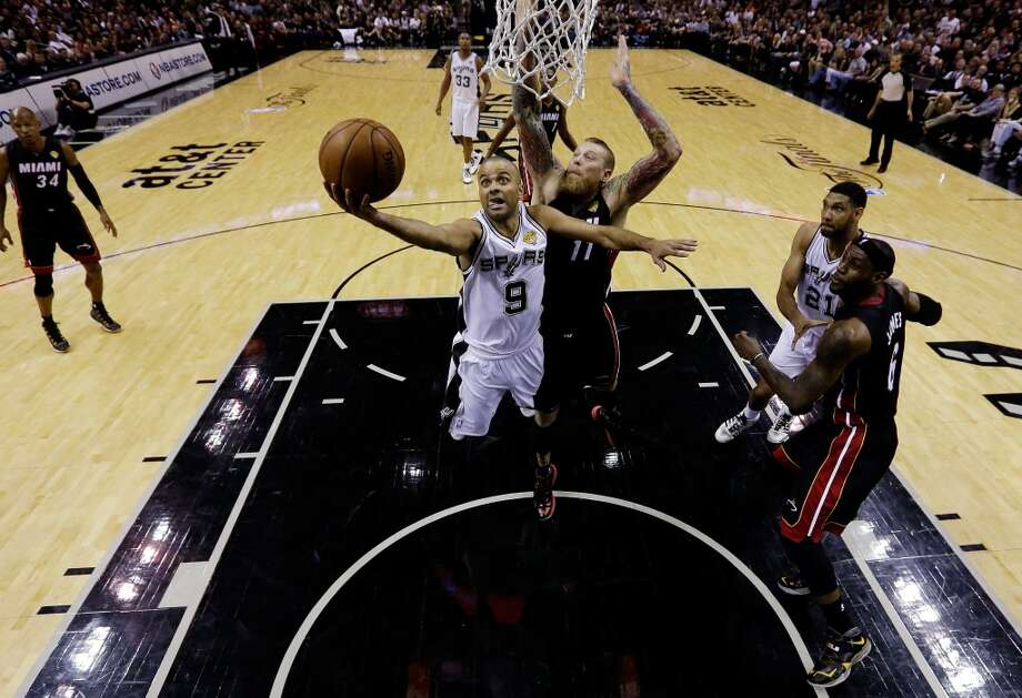Tony Parker goes to the basket against Chris Andersen during Game 5. Photo: Pool, Getty Images