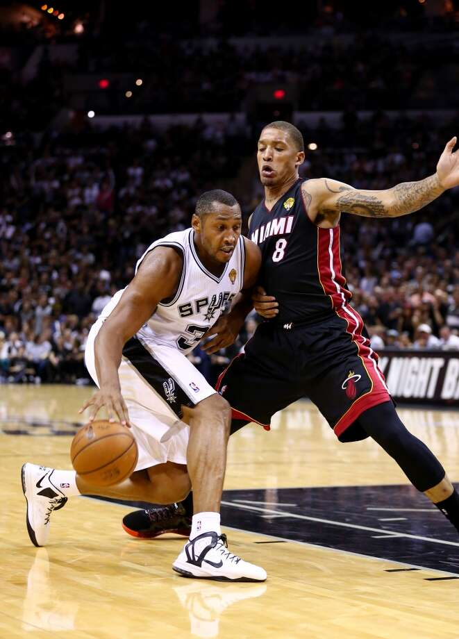 Boris Diaw drives to the basket against Michael Beasley during Game 5. Photo: Andy Lyons, Getty Images