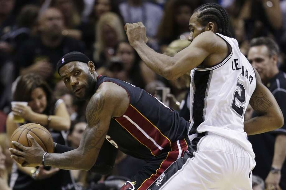 LeBron James  looks past defender Kawhi Leonard during the second half in Game 5. Photo: David J. Phillip, Associated Press