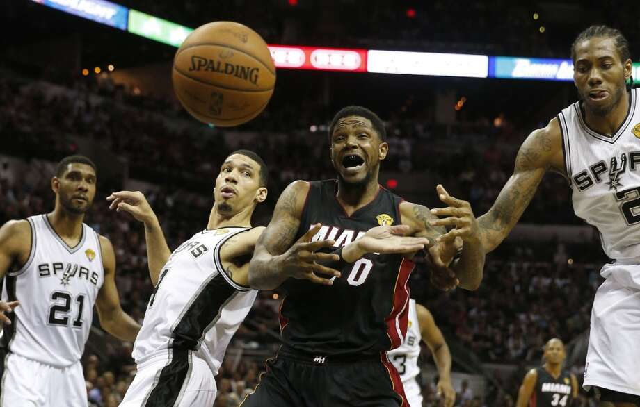 Udonis Haslem, center, fights Danny Green for a ball in the second quarter in Game 5. Photo: CHARLES TRAINOR JR, McClatchy-Tribune News Service