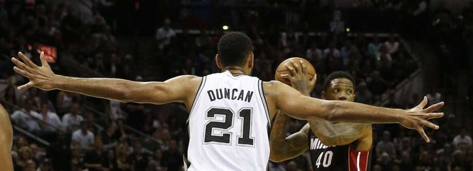 Miami Heat's Udonis Haslem is defended by San Antonio Spurs' Tim Duncan in the second quarter in Game 5 of the NBA Finals at the AT&T Center in San Antonio, Texas, on Sunday, June 15, 2014. (Charles Trainor Jr./Miami Herald/MCT) Photo: CHARLES TRAINOR JR, McClatchy-Tribune News Service