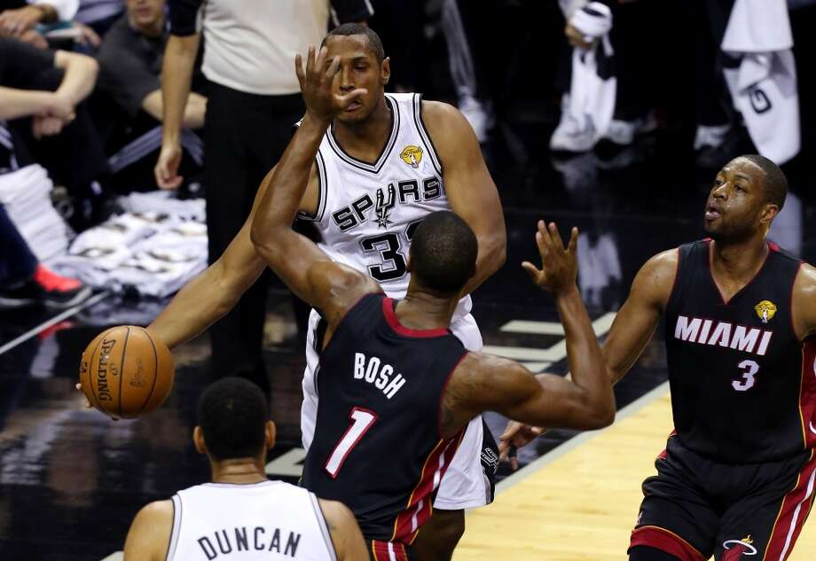 SAN ANTONIO, TX - JUNE 15: Boris Diaw #33 of the San Antonio Spurs makes a pass as Chris Bosh #1 of the Miami Heat defends during Game Five of the 2014 NBA Finals at the AT&T Center on June 15, 2014 in San Antonio, Texas. NOTE TO USER: User expressly acknowledges and agrees that, by downloading and or using this photograph, User is consenting to the terms and conditions of the Getty Images License Agreement.  (Photo by Chris Covatta/Getty Images) Photo: Chris Covatta, Getty Images