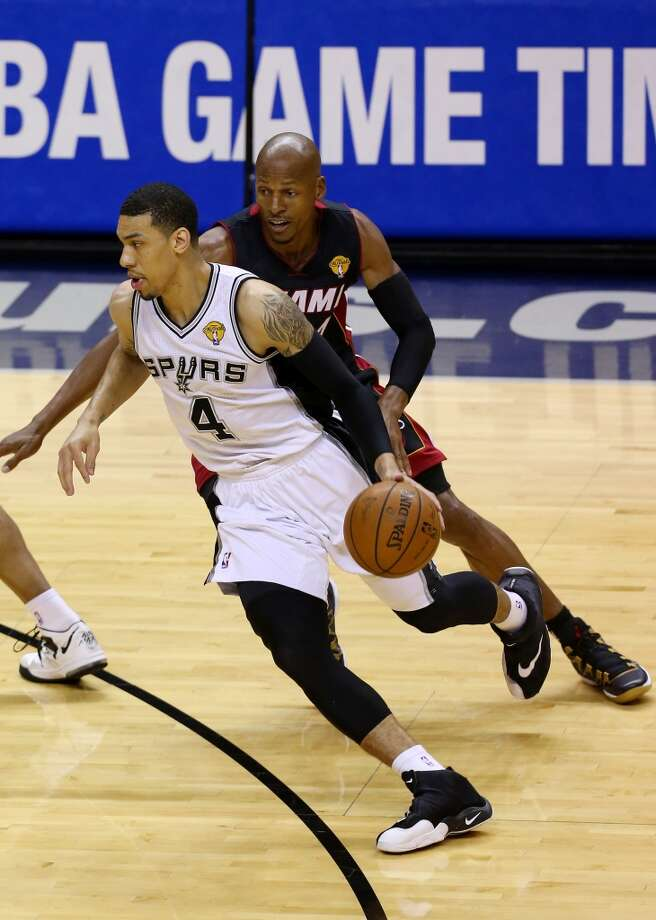 SAN ANTONIO, TX - JUNE 15: Danny Green #4 of the San Antonio Spurs drives to the basket as Ray Allen #34 of the Miami Heat defends during Game Five of the 2014 NBA Finals at the AT&T Center on June 15, 2014 in San Antonio, Texas. NOTE TO USER: User expressly acknowledges and agrees that, by downloading and or using this photograph, User is consenting to the terms and conditions of the Getty Images License Agreement.  (Photo by Chris Covatta/Getty Images) Photo: Chris Covatta, Getty Images