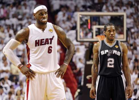 Miami Heat's LeBron James and San Antonio Spurs' Kawhi Leonard pause during free throws in Game 3 of the NBA Finals Tuesday June 10, 2014 at American Airlines Arena in Miami, Fla. Photo: Edward A. Ornelas, San Antonio Express-News