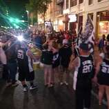 Spurs fans celebrate downtown after the team won its fifth title on Sunday, June 15, 2014.