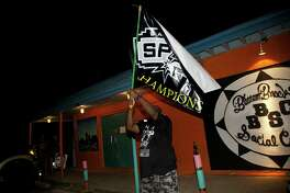 Spurs fans gather at the Bottom Bracket Social Club to watch as the Spurs won the title, beating the Heat in Game 5 of the NBA Finals, on Sunday, June 15, 2014.