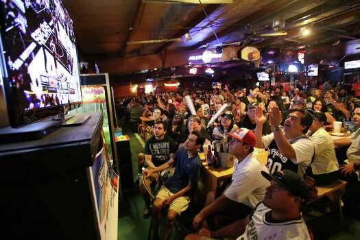 Spurs fans watch Game 5 of the NBA Finals on Sunday, June 15, 2014, at Fatso's Sports Garden in San Antonio. General manager Jim Woods estimated about 500 customers were present to watch the game. Photo: Timothy Tai, Express-News Staff / © 2014 San Antonio Express-News