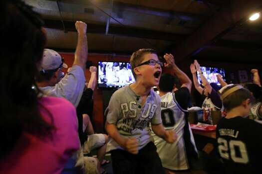 John Arredondo, 12, reacts after a point by the Spurs during Game 5 of the NBA Finals on Sunday, June 15, 2014, at Fatso's Sports Garden in San Antonio. General manager Jim Woods estimated about 500 customers were present to watch the game. Photo: Timothy Tai, Express-News Staff / © 2014 San Antonio Express-News