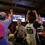 John Arredondo, 12, center, reacts after a point by the Spurs during Game 5 of the NBA Finals on Sunday, June 15, 2014, at Fatso's Sports Garden in San Antonio. General manager Jim Woods estimated about 500 customers were present to watch the game.